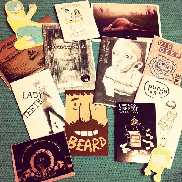 seasonoffevers:  2013 Chicago Zine Fest haul. 'twas a blast. #zinefest #chicagozinefest #zines  Aw, neat! My stickers are in here. And my zine Life is Beautiful (as well as my collaborative zine This Could Be You, But It's Not)!
