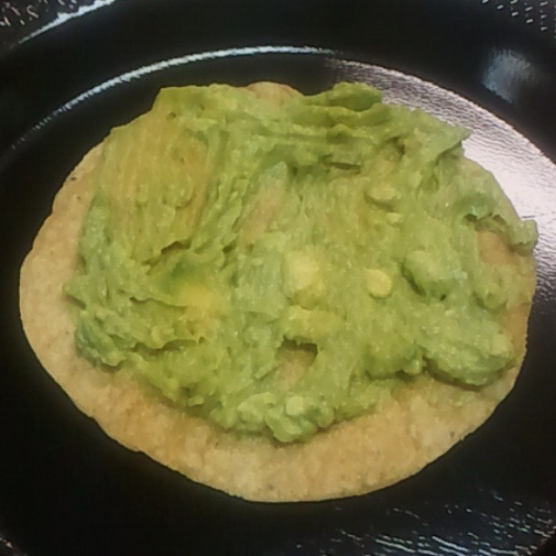 Homemade guacamole on tostadas