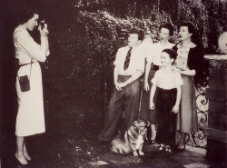 A young Julie Andrews taking a picture of family members.