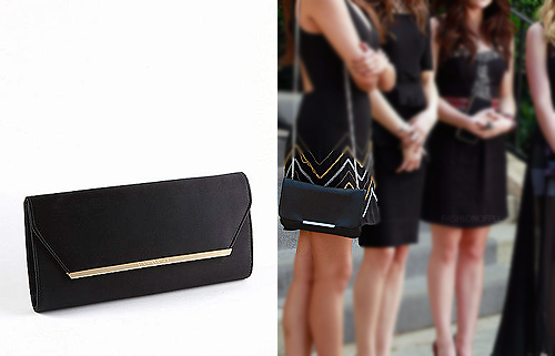 I had no luck identifying Emily's exact clutch but I did find a similar one. Best part? It's on sale!  BCBGMAXAZRIA - Helen Satin Envelope Clutch - $58.00