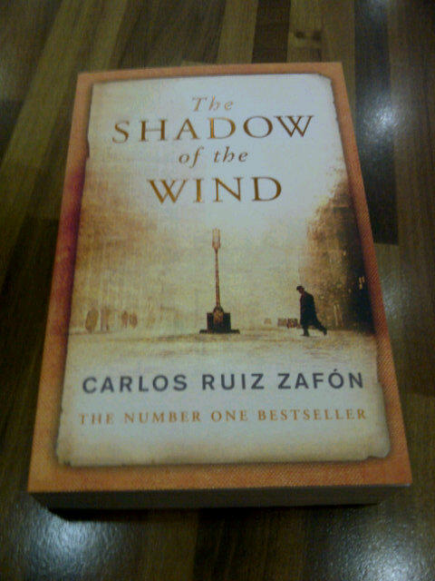 backtotheshadows:  The Shadow of The Wind - Carlos Ruiz Zafón  Infinite Love and a Circle of Bliss! I LOVE IT! :::::::::::::::::: Barcelona, 1945: A city slowly heals in the aftermath of the Spanish Civil War, and Daniel, an antiquarian book dealer's son who mourns the loss of his mother, finds solace in a mysterious book entitled The Shadow of the Wind, by one Julián Carax. But when he sets out to find the author's other works, he makes a shocking discovery: someone has been systematically destroying every copy of every book Carax has written. In fact, Daniel may have the last of Carax's books in existence. Soon Daniel's seemingly innocent quest opens a door into one of Barcelona's darkest secrets—an epic story of murder, madness, and doomed love.(
