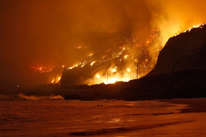 inothernews:  TOASTED COAST  Wildfires rage along the Californian coast north of Los Angeles.  (Photo:  Jonathan Alcorn / Reuters via The Guardian)