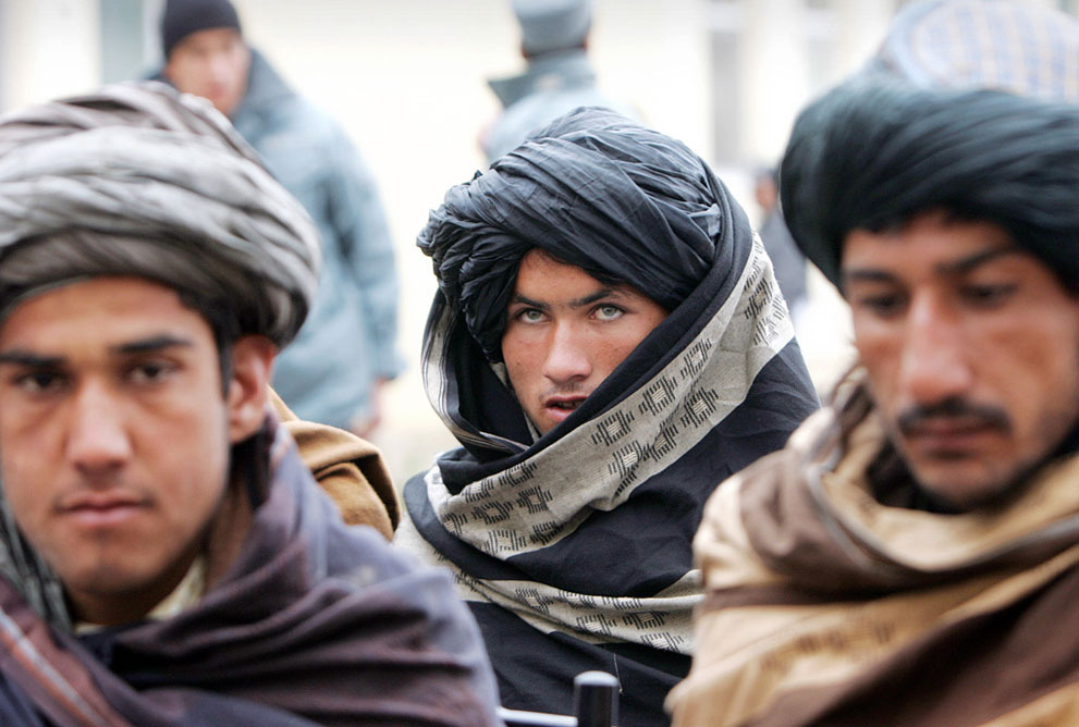 Former Taliban militants attend a ceremony with the Afghan government after handing over their weapons in Herat, on February 17, 2013.