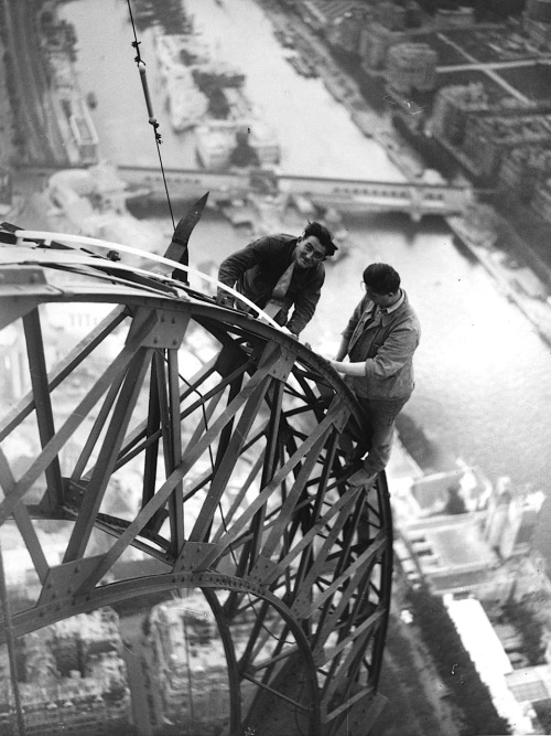 Unknown Photographer Electricians Working on the Eiffel Tower, Paris, 1937. From Museum Syndicate