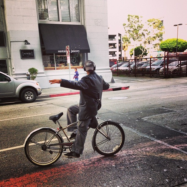 He only rides backwards #dtla #culture #tbt