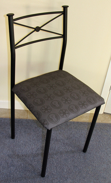 emiisaurus:  anariazarrel:  Dining chairs with a Star Wars touch on Flickr. Time to recover our dining room chairs, we decided to add a little Star Wars touch - custom printed fabric with SWTOR logos :)  -grabby hands-
