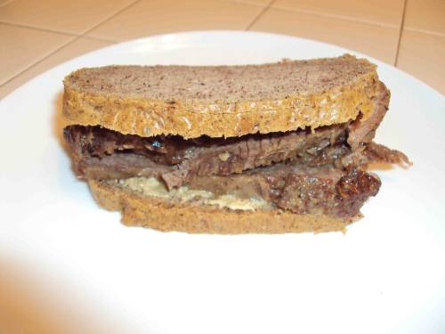 Grass-fed brisket sandwich with homemade caveman ketchup and organic mustard on paleo almond butter bread.  It's the simplest things I like the best.