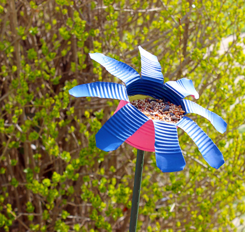 Tin Can Flower Bird Feeder {How to} Found at: thinkcrafts