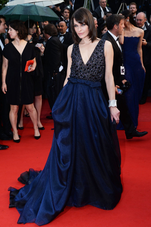 elizabethswardrobe:  Milla Jovovich in Giorgio Armani at the premiere of All Is Lost at the Cannes Film Festival. I love this gown, despite its similarities to her Prada number last night. I'm a sucker for a princess skirt.