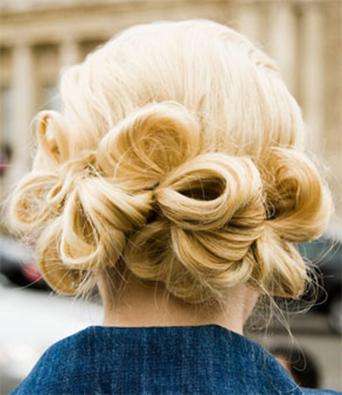 fuckyeahrunwayhair:  Loop chignon - make three ponytails just above the nape of your neck, and spray the sections with hairspray. Then working from the outer ponytails in, make loops with small sections of hair and pin in place.