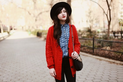 A polka-dotted denim top pairs perfectly with a bright red cardigan in this look from Binnie of Flashes of Style.