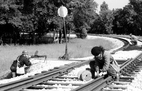 Members of the France Resistance trapping railway tracks.