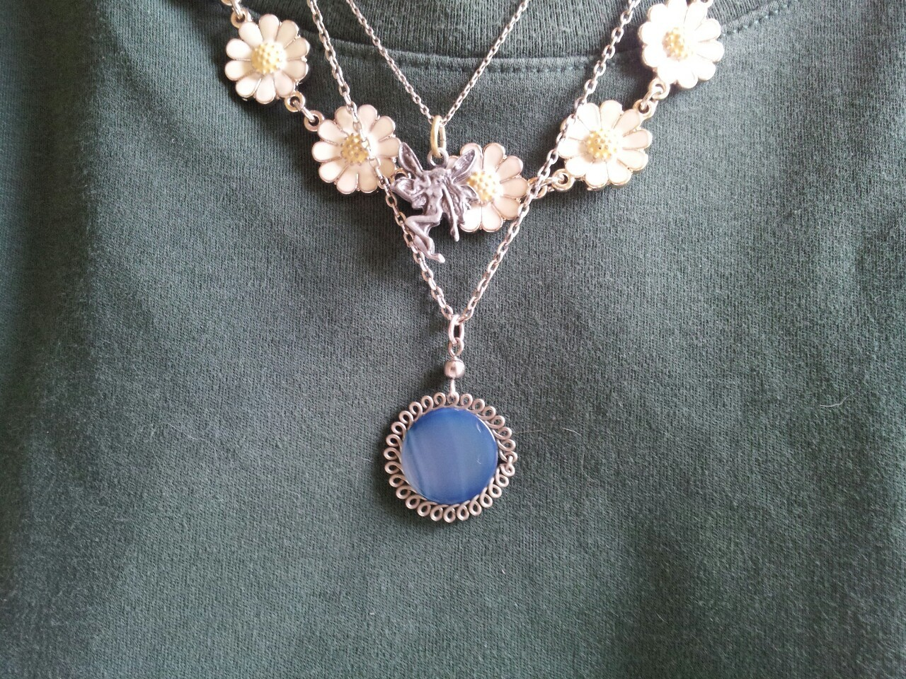 yourmotherseyes:  i like my necklaces today :) faery necklace - frances gave it to me  daisy necklace -accessorize blue necklace - from a bracelet i bought for a couple of euros in Barcelona