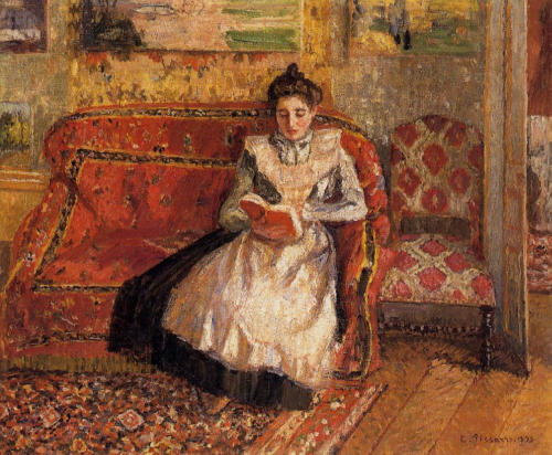 books0977:  Jeanne Pissarro, Called Cocotte, Reading (1899). Camille Pissarro (French-Danish, Impressionism, Neo-Impressionism, 1830–1903). Oil on canvas. Collection of Ann and Gordon Getty. The artist's daughter wears a long black dress covered by a full-length apron as she sits on a sofa reading her book. It's a quiet scene that gains visual energy from the contrasting colors and textures of the upholstered furniture, oriental rug and busy wallpaper.