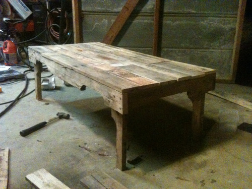 Finished my table.  Third project of Christmas break.  It's made entirely out of wood from two discarded pallets.