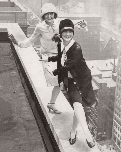 Two flappers dancing the Charleston on the rooftop of Sherman Hotel, Chicago, 1926.