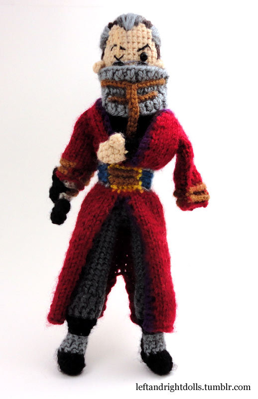 leftandrightdolls:  Finished Auron from FFX, as chosen by needs-coffee for winning my giveaway drawing earlier this spring.  He would have been done much sooner if not for his face; a HUGE thanks to the lovely and talented Shestval for helping get that right for me.  You can't quite make it out, but there's sunglasses and a grimace under that big belty cowl. XD This doll obviously isn't for sale, but I have plenty of others that are.  I also do commissions. Congrats again to needs-coffee for winning the contest!