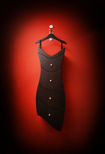 Yes, it's a dresser, designed like a little black dress and it can be hang from a hanger.