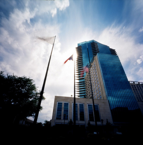Omni & Flags - Pinhole on Flickr.Via Flickr: The Omni Hotel & condos tower, overlooking the Water Gardens in downtown Fort Worth.  Taken with my Zero Image pinhole.