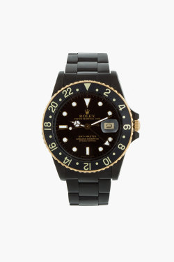 coldheartsandhotnights:  Matte Black and Gold Rolex GMT Master I