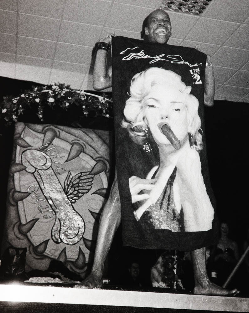 Male stripper with Marylin beach towel. at porn-as-art.tumblr.com