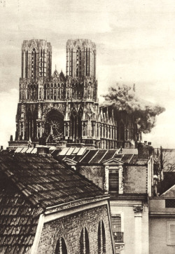 A German shell strikes the Cathedral of Rheims. France, 1916. Underwood & Underwood