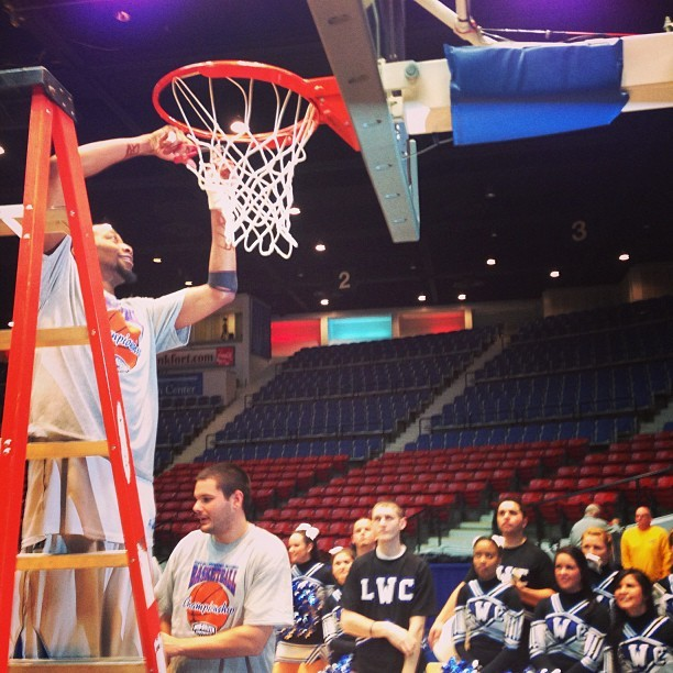 @LWCAthletics men's basketball cuts nets after winning @MidSouthSports tourney title.