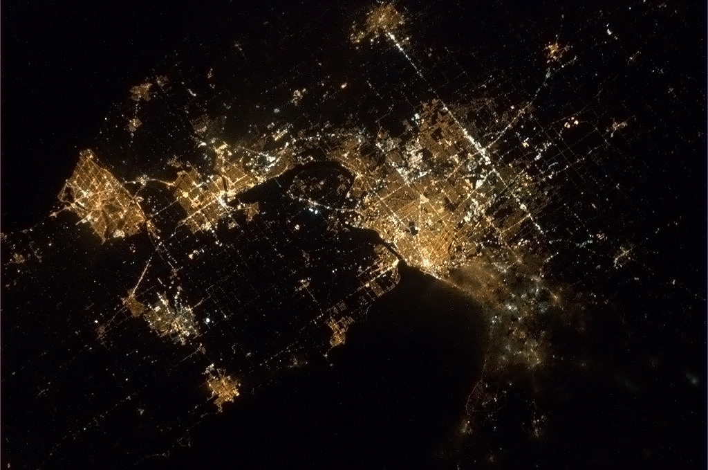 colchrishadfield:  Niagara Falls in the night, and all the surrounding towns from St Catharines ON to Buffalo NY.  I've been waiting for some Buffalove from Com. Hadfield. What he is doing is amazing. If you're doing the twitter thing, do yourself a favor and follow him immediately. Last time I looked he only had just over 400K followers. Only, because he should have millions. His pics from the ISS are astounding. Now if I can only get a Seattle/Tacoma shot!