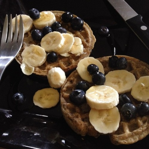 Flaxseed multigrain waffles with bananas, blueberries, and agave.