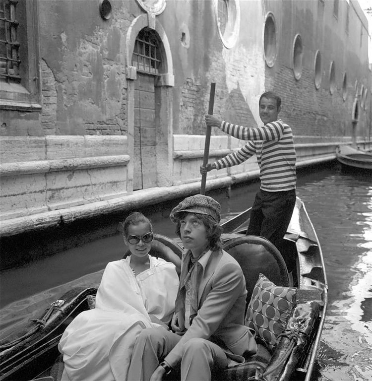 Venice 1. Mick Jagger in Tommy Nutter (Edward Sexton), with Bianca, 1971.