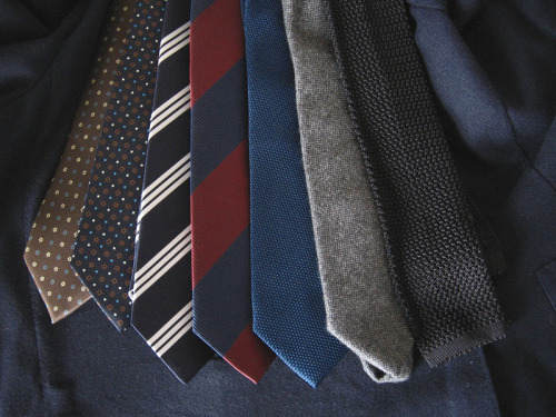 "The Most Basic Ties Like any part of a good wardrobe, building the right collection of neckties requires some forethought and planning. There are hundreds, if not thousands, of beautiful neckties out there, but not all of them will be worth buying. Knowing which ones are requires some thinking about what you plan to wear your ties with.   If you wear suits often, consider silk foulards. Foulards are those small-scale, symmetrical patterns featuring things such as medallions, florets, or geometric shapes. They're typically conservative in nature and printed on medium weight silks. These will be good in dark colors such as navy, burgundy, dark green, or dark brown. Pick something with a bit of light blue or white somewhere in the pattern and you have the advantage of picking up the color in your shirt. If you mostly wear sport coats instead, then focus on repp stripes. It's not that you can't wear silk foulards with a sport coat, it's that often you're safer off – if not better off – with something striped. Dark ties with small repeating geometrics are often a bit too ""suit-ish"" for odd jackets. Plus, if push came to shove, you can usually wear a repp-striped tie with a suit, at least to most occasions. Again, focus on dark colors, as those will be the easiest to wear, and try to get ties in various scales of pattern. Some ensembles look better with big block stripes, while others will call for a thinner stripes. It's nice to have some flexibility. Finally, it's always good to have some solid-colored, but also textured, ties on hand. These include woven grenadines, fuzzy wools, and silk knits. Such ties pair especially well with rustic sport coats or suits, such as those made from tweed or corduroy, and they're quite useful if you wear patterned shirts often. You can wear a patterned tie with a patterned shirt, but a solid, yet textured one will take less thinking and always be tasteful. Of course, these aren't the only ties worth buying, and as you expand your collection, it can be nice to pick up things such as dotted silks, ancient madders, and even some unusual designs. However, the above sets a good foundation and helps underscore something important: no matter what you choose for yourself, buy ties that work well with what you typically wear, not just ones that happen to look good on a store's counter."