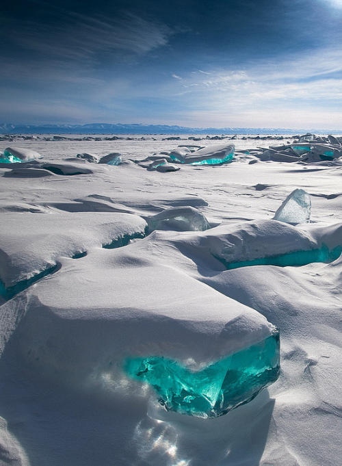 "mermaidporn:  ""In March, due to a natural phenomenon, Siberia's Lake Baikal is particularly amazing to photograph. The temperature, wind and sun cause the ice crust to crack and form beautiful turquoise blocks or ice hummocks on the lake's surface."" Photograph by Alex El Barto."