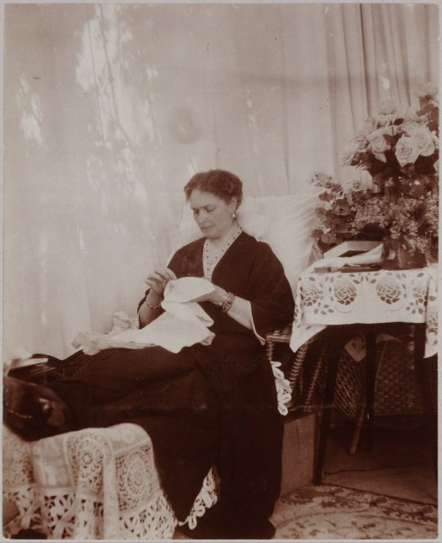 Alexandra Feodorovna doing some needlework: 1916.