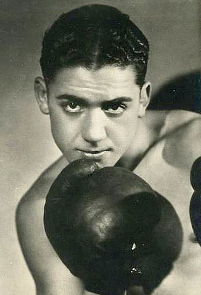 "nostalgerie:  Tunisian Jewish boxing champion Victor Perez who survived by boxing until 1945, when he died during the death march from Auschwitz.   He was born to Khmaïssa Perez on October 18, 1911, and was raised in the Jewish quarter of Tunis. At age 14, alongside his older brother, he started training to be a boxer after being inspired by Senegalese boxer Battling Siki. Standing at 5'1"" and weighing 110lbs, Perez defeated Kid Oliva from Marseille to win the Flyweight title in Paris in 1930. The following year he won the International Boxing Union's version of the Flyweight crown after knocking out American champion Frankie Genaro. This victory made him the youngest world boxing champion in history.  In September 1943, following the German Nazi invasion of France during the Second World War, Perez was denounced to the occupation authorities and was arrested and detained at the Drancy internment camp before being transported to Auschwitz in October. There, he was assigned to the Monowitz subcamp to serve as a slave laborer for I.G. Farben at the Buna-Werke.  Perez was killed on January 22, 1945 on the death march from Monowitz to Gleiwitz. In 1986, Perez was inducted into the International Jewish Sports Hall of Fame. Read more profiles of notable Africans."