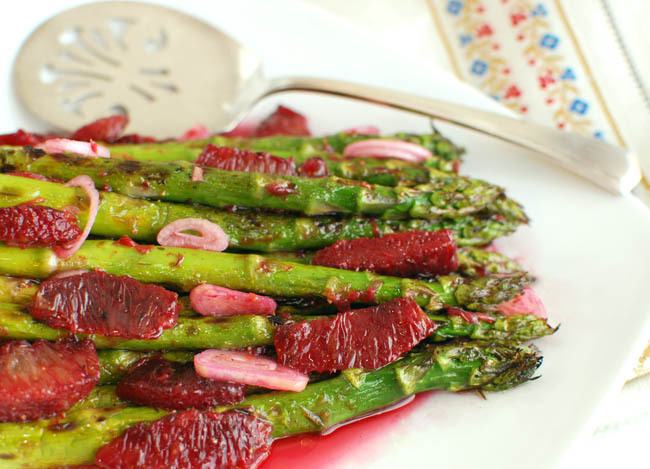Asparagus with Orange Vinaigrette:  Grilling the asparagus brings a charred earthy flavor to balance both the sweet citrus segments and the acidity of the vinaigrette. So gather round the BBQ and celebrate spring by chowing down on asparagus tossed with blood orange and shallot. This recipe comes to us from Kristina of FormerChef.com.
