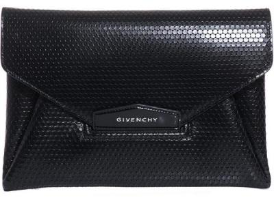 Givenchy Leather Envelope Clutch Bag Clutch bags are an essential to every wardrobe. As simple as it may appear, this little Givenchy makes a major impact in both style and functionality.  It offers an envelope front flap, folded sides, a silver-metal logo clasp, three internal compartments, and fabulously textured leather detailing. This piece is perfect if you are looking to add a little luxe and flirty sophistication to your look. (Read More on HauteChicago.Com)
