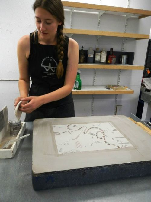 Proofing for Dyani White Hawk, part of Landmarks at Tamarind Institute  from Tamarind's facebook page