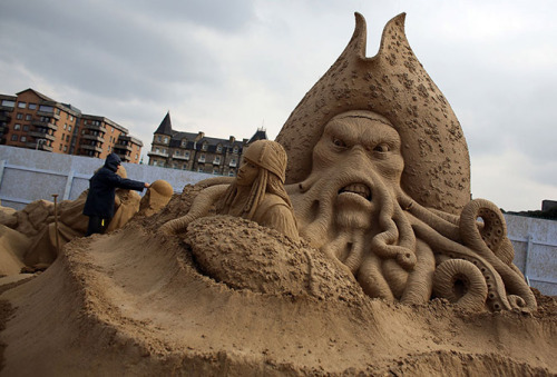 "archiemcphee:  These awesome photos are from the 2013 Weston Sand Sculpture Festival on the sandy shores of Weston-super-Mare in Somerset, England. Each year the festival has a different theme and this year's theme is Hollywood.  ""Since the festival started in 2006, themes have included Fairy Tales, The Continents of the World, Under the Ocean, Great Britain, and The Jungle. What began with two Dutch sand sculptors building a giant King Kong from 30 tonnes of sand has now turned into a world famous get-together of some of the niftiest hands in sand sculpting. More than 20 of the world's greatest sculptors from nine different countries are working away using 4,000 tonnes of sand from the beach.""  The festival opened on Good Friday and runs through the end of September. Visit Dailymail.co.uk to view more of the awesome sand sculptures from this year's Weston Sand Sculpture Festival. [via Free York and Dailymail.co.uk]"