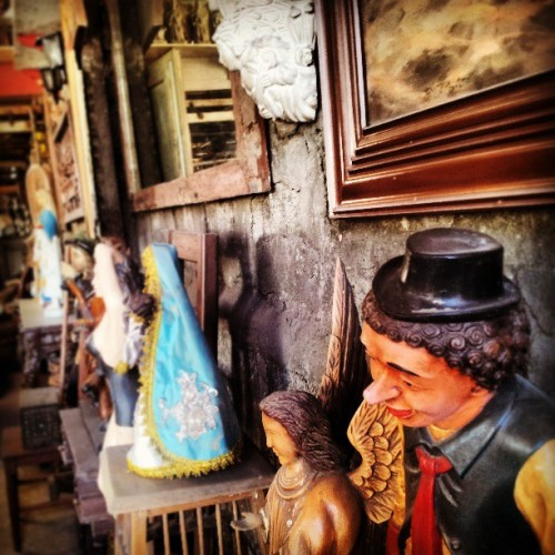 Salvaged paintings and figurines. I wonder what stories they tell. (at Anna's Antiques)