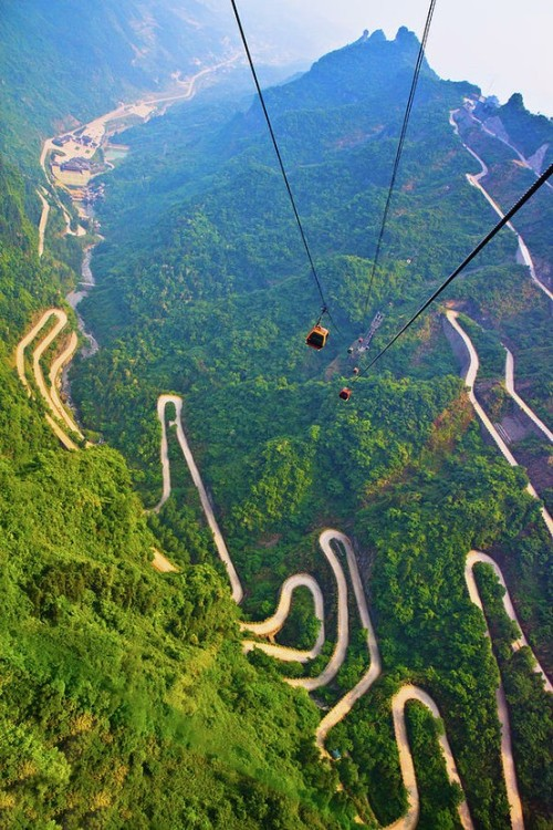 bitchville:  The mountains and winding road in Mount Tianmen, National Forest Park in western Hunan province of China. Taken by Feng Wei