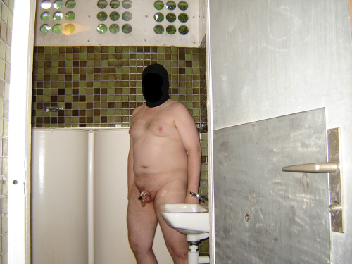 Last task of my keyholder: 1 photo by the sinks in a public bathroom.  Full body shot (blur your face if you wish).  Leave your clothes in a stall and take a photo of yourself by the sinks. I don't like to go to public toilet, it's always so filthy and stinks… and it is even more embarrassing to be there totally naked, just with a tiny cock locked in a CB6000s… I put my clothes in the stall and just wanted to go out, all nude, when the outside door opened. I just had enough time to close the door of my stall and wait till a boy (I think he was about 17-18) finished pissing. I even heard him zipping up his pants, washing his hands and than he left… I was really in a hurry to take this damn picture and put my clothes back on before another one entered… I don't want to think about what could have happened if I was discovered, nude and caged, by some guys in a public toilet… you could only hope the only thing they would use is the toilet…