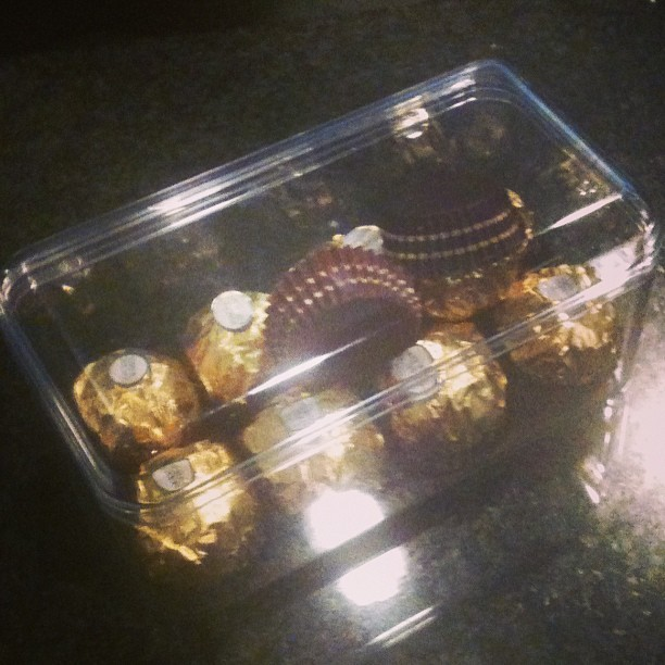 "Does this abandoned, partially-consumed box of Ferrero Roche fall under ""see something say something?"" (at San Francisco International Airport (SFO))"