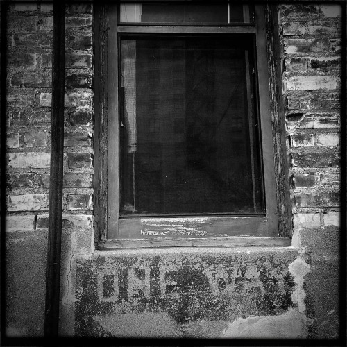 """One Way""   For your daily dose of Hipstamatic this image of a window with writing.  This is on some building in a back alley in downtown Fargo, North Dakota.  I have no idea why it says ""One Way""  I guess if you going in and out the window it works. Hipstamatic 261, John S lens, Black Keys Film no flash Check out my blog at http://hipstamaticpics.com"