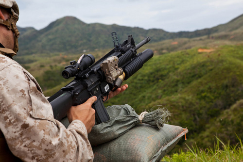 Infantrymen sharpen skills during live-fire training by III Marine Expeditionary Force/MCI Pacific on Flickr.Via Flickr: 130429-M-FD301-078 Lance Cpl. Devon T. Voorhees loads an M203 grenade launcher during weapons systems familiarization and fire-and-maneuver exercises at Range 2 on Camp Hansen April 29. Marines also fired the M203 grenade launcher, AT-4 light anti-armor weapon and the MK153 shoulder-fired multipurpose assault weapon to increase proficiency. Following the weapons systems familiarization training, Marines conducted fire-and-maneuver rehearsals. Voorhees is a rifleman with 3rd Battalion, 6th Marine Regiment, which is currently assigned to 4th Marine Regiment, 3rd Marine Division, III Marine Expeditionary Force, under the unit deployment program.  (U.S. Marine Corps photo by Pfc. Kasey Peacock/Released)