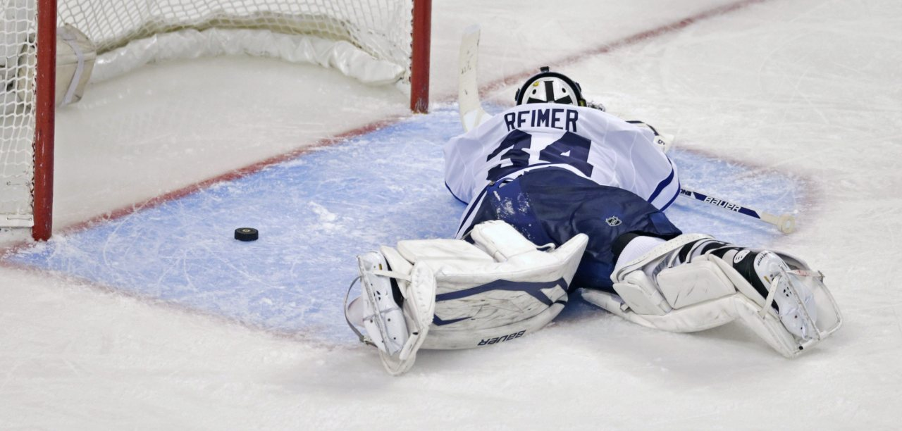 nationalpostsports:  This sums it up: Leafs goaltender James Reimer laid face-down on the ice for minutes after Patrice Bergeron scored for the Bruins in overtime — capping an amazing comeback after Toronto held a 4-1 lead in the third period. (Photo: Charles Krupa/The Associated Press)