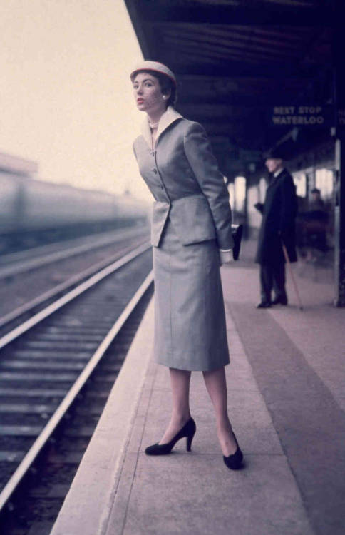 A woman stands on a station platform, watching for her train. (via The Ways We Wait: A Train Station Tribute For Grand Central's 100th : The Picture Show : NPR)