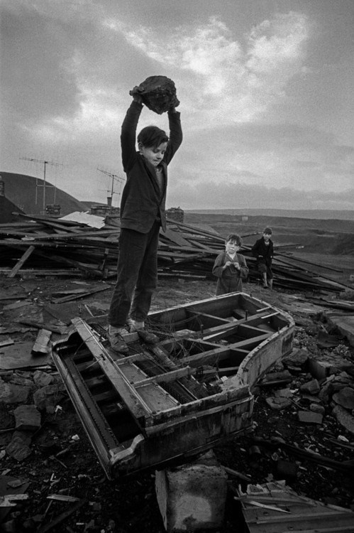Phillip Jones Griffiths' Boy Destroying Piano, 1961 (via Iconic Photos)