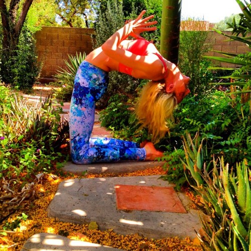 gypsetgoddess:  Camel pose in the garden. 🌳 🌸 #maytheforcebewithyogis