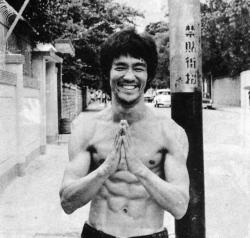 "fckyeahundergroundhiphop:    Bruce Lee had me up to three miles a day, really at a good pace. We'd run the three miles in twenty-one or twenty-two minutes. Just under eight minutes a mile [Note: when running on his own in 1968, Lee would get his time down to six-and-a half minutes per mile]. So this morning he said to me ""We're going to go five."" I said, ""Bruce, I can't go five. I'm a helluva lot older than you are, and I can't do five."" He said, ""When we get to three, we'll shift gears and it's only two more and you'll do it."" I said ""Okay, hell, I'll go for it."" So we get to three, we go into the fourth mile and I'm okay for three or four minutes, and then I really begin to give out. I'm tired, my heart's pounding, I can't go any more and so I say to him, ""Bruce if I run any more,"" –and we're still running-""if I run any more I'm liable to have a heart attack and die."" He said, ""Then die."" It made me so mad that I went the full five miles. Afterward I went to the shower and then I wanted to talk to him about it. I said, you know, ""Why did you say that?"" He said, ""Because you might as well be dead. Seriously, if you always put limits on what you can do, physical or anything else, it'll spread over into the rest of your life. It'll spread into your work, into your morality, into your entire being. There are no limits. There are plateaus, but you must not stay there, you must go beyond them. If it kills you, it kills you. A man must constantly exceed his level.""   The man"