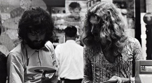 vinylespassion:  Jimmy Page and Robert Plant at Bleecker Bob's.